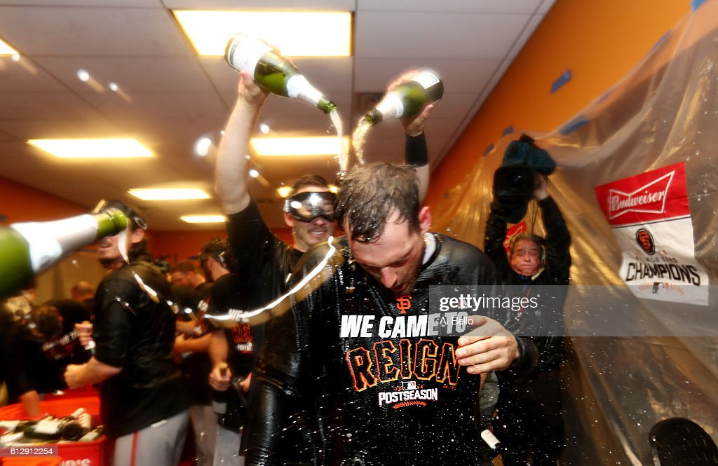 Conor Gillaspie #21 of the San Francisco Giants celebrates their 3-0 victory over the New York Mets in the locker room after their National League Wild Card game at Citi Field on October 5, 2016 in New York City.