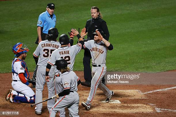Conor Gillaspie of the San Francisco Giants celebrates with teammates after hitting a threerun homerun in the ninth inning against the New York Mets...