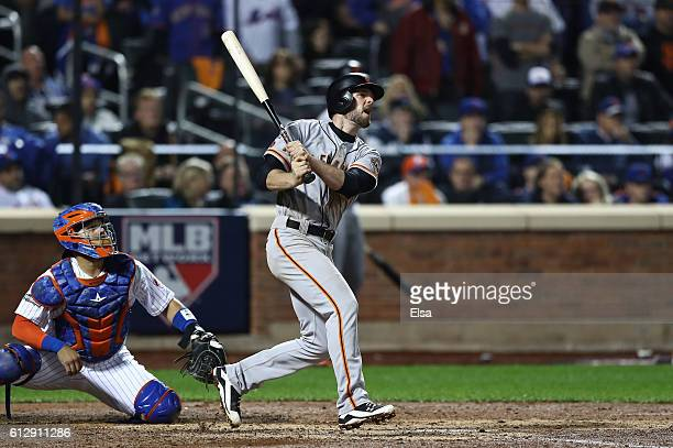 Conor Gillaspie of the San Francisco Giants hits a threerun homerun in the ninth inning against the New York Mets during their National League Wild...