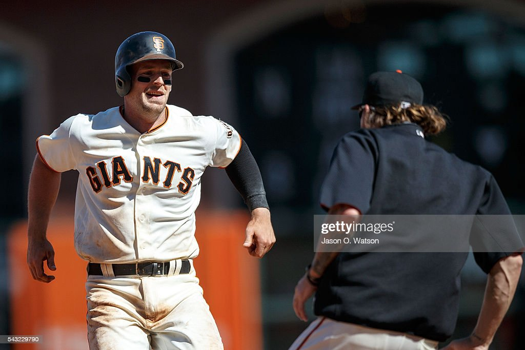 <a gi-track='captionPersonalityLinkClicked' href=/galleries/search?phrase=Conor+Gillaspie&family=editorial&specificpeople=5115369 ng-click='$event.stopPropagation()'>Conor Gillaspie</a> #21 of the San Francisco Giants is congratulated by teammates after hitting a walk off single against the Philadelphia Phillies during the ninth inning at AT&T Park on June 26, 2016 in San Francisco, California. The San Francisco Giants defeated the Philadelphia Phillies 8-7.