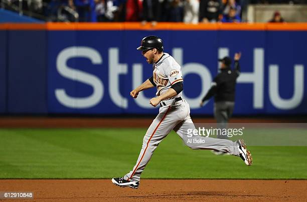 Conor Gillaspie of the San Francisco Giants runs the bases as he celebrates his threerun homerun in the ninth inning against the New York Mets during...