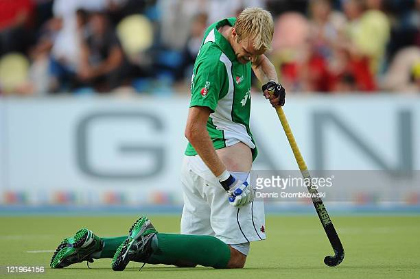 Conor Harte of Ireland kneels on the pitch after getting hit by a ball during the Men´s EuroHockey Championships 2011 Pool B match between...