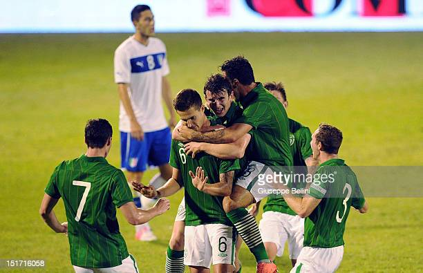 Conor Henderson of Republic of Ireland celebrates after scoring goal 13 during the UEFA Under21 Championship qualifying round match between Italy and...