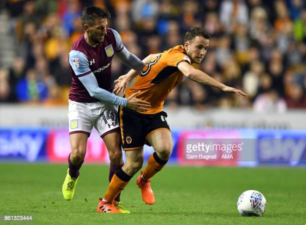 Conor Hourihane of Aston Villa and Diogo Jota of Wolverhampton Wanderers during the Sky Bet Championship match between Wolverhampton and Aston Villa...