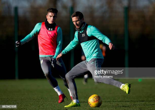 Conor Hourihane of Aston Villa in action with team mate Jack Grealish during training session at the club's training ground at Bodymoor Heath on...