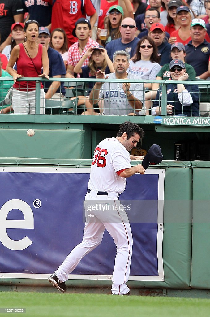 <a gi-track='captionPersonalityLinkClicked' href=/galleries/search?phrase=Conor+Jackson&family=editorial&specificpeople=593147 ng-click='$event.stopPropagation()'>Conor Jackson</a> #36 of the Boston Red Sox runs into the wall chasing a hit by Ian Kinsler #5 of the Texas Rangers on September 4, 2011 at Fenway Park in Boston, Massachusetts.