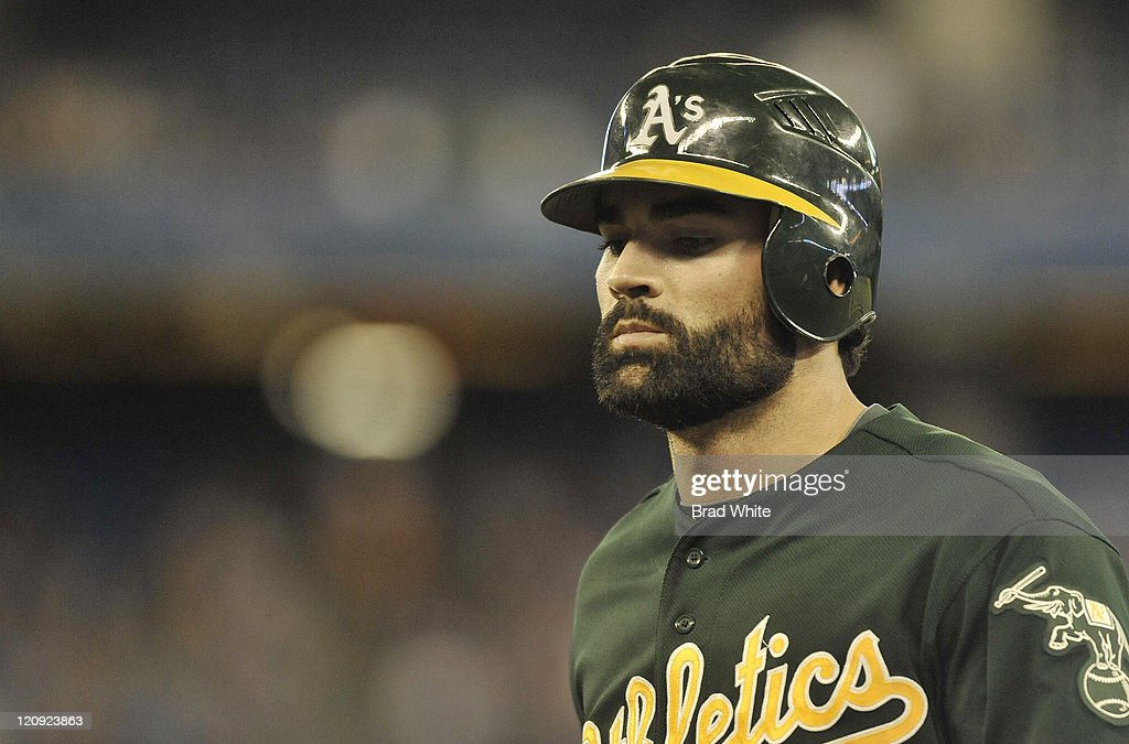 <a gi-track='captionPersonalityLinkClicked' href=/galleries/search?phrase=Conor+Jackson&family=editorial&specificpeople=593147 ng-click='$event.stopPropagation()'>Conor Jackson</a> #28 of the Oakland Athletics looks on during the game against the Toronto Blue Jays August 9, 2011 at Rogers Centre in Toronto, Ontario, Canada.