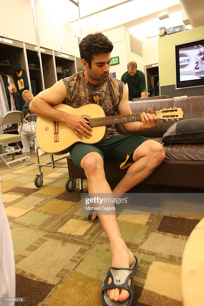 <a gi-track='captionPersonalityLinkClicked' href=/galleries/search?phrase=Conor+Jackson&family=editorial&specificpeople=593147 ng-click='$event.stopPropagation()'>Conor Jackson</a> #28 of the Oakland Athletics plays guitar in the clubhouse before the game against the Detroit Tigers at Oakland-Alameda County Coliseum on April 17, 2010 in Oakland, California. The Oakland Athletics defeated the Tigers 5-1.