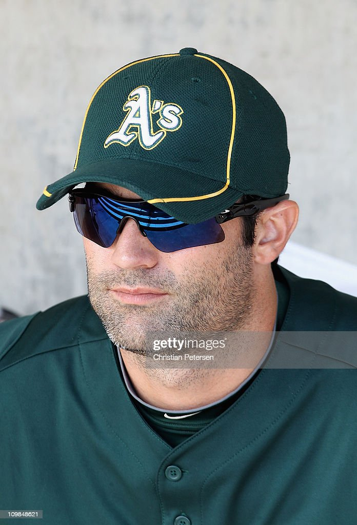 <a gi-track='captionPersonalityLinkClicked' href=/galleries/search?phrase=Conor+Jackson&family=editorial&specificpeople=593147 ng-click='$event.stopPropagation()'>Conor Jackson</a> #28 of the Oakland Athletics sits in the dugout during the spring training game against the Milwaukee Brewers at Maryvale Baseball Park on March 3, 2011 in Phoenix, Arizona.