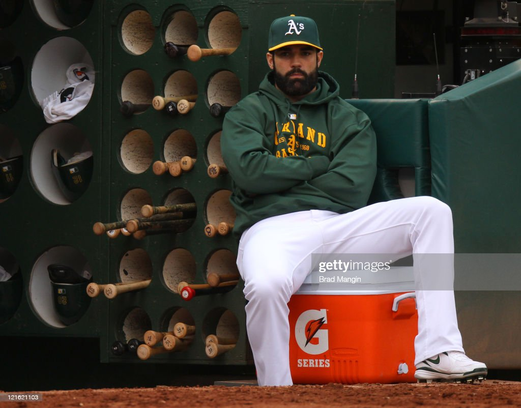 <a gi-track='captionPersonalityLinkClicked' href=/galleries/search?phrase=Conor+Jackson&family=editorial&specificpeople=593147 ng-click='$event.stopPropagation()'>Conor Jackson</a> #28 of the Oakland Athletics watches from the dugout and sits on a Gatorade cooler during the game against the Toronto Blue Jays at O.co Coliseum on August 20, 2011 in Oakland, California.