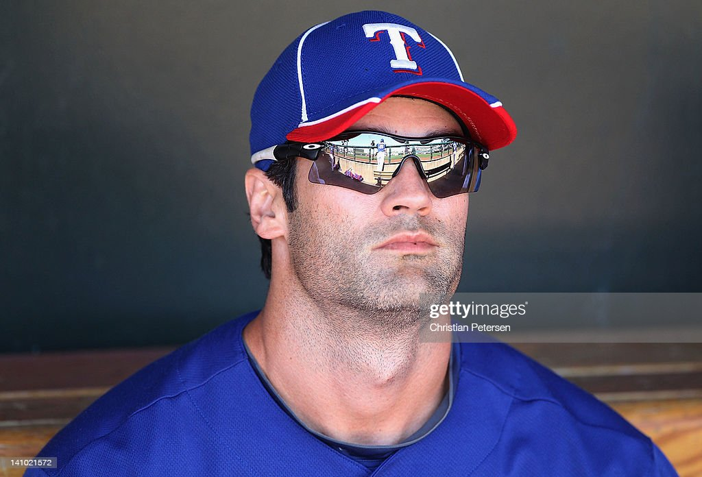 <a gi-track='captionPersonalityLinkClicked' href=/galleries/search?phrase=Conor+Jackson&family=editorial&specificpeople=593147 ng-click='$event.stopPropagation()'>Conor Jackson</a> #28 of the Texas Rangers sits in the dugout during the spring training game against the Los Angeles Dodgers at Surprise Stadium on March 9, 2012 in Surprise, Arizona.