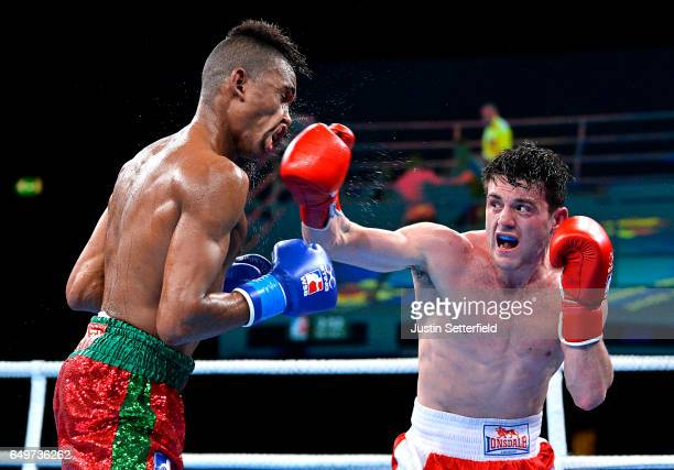 Conor Loftus of British Lionhearts connects with a right against Youness Baati of Morocco Atlas Lions in the Light Welter weight bout during the...
