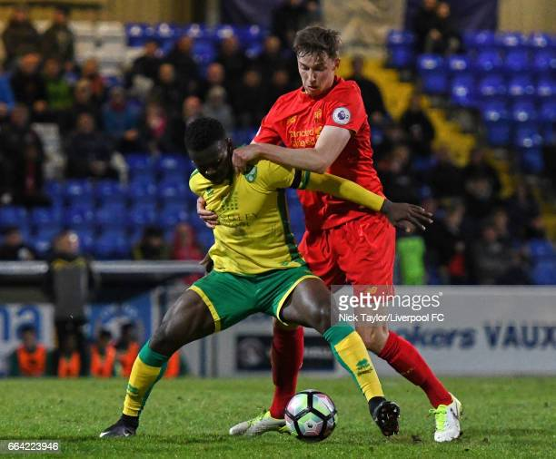 Conor Masterson of Liverpool and Diallang Jaiyesimi of Norwich City in action during the Liverpool v Norwich City U23 Premier League Cup game at...
