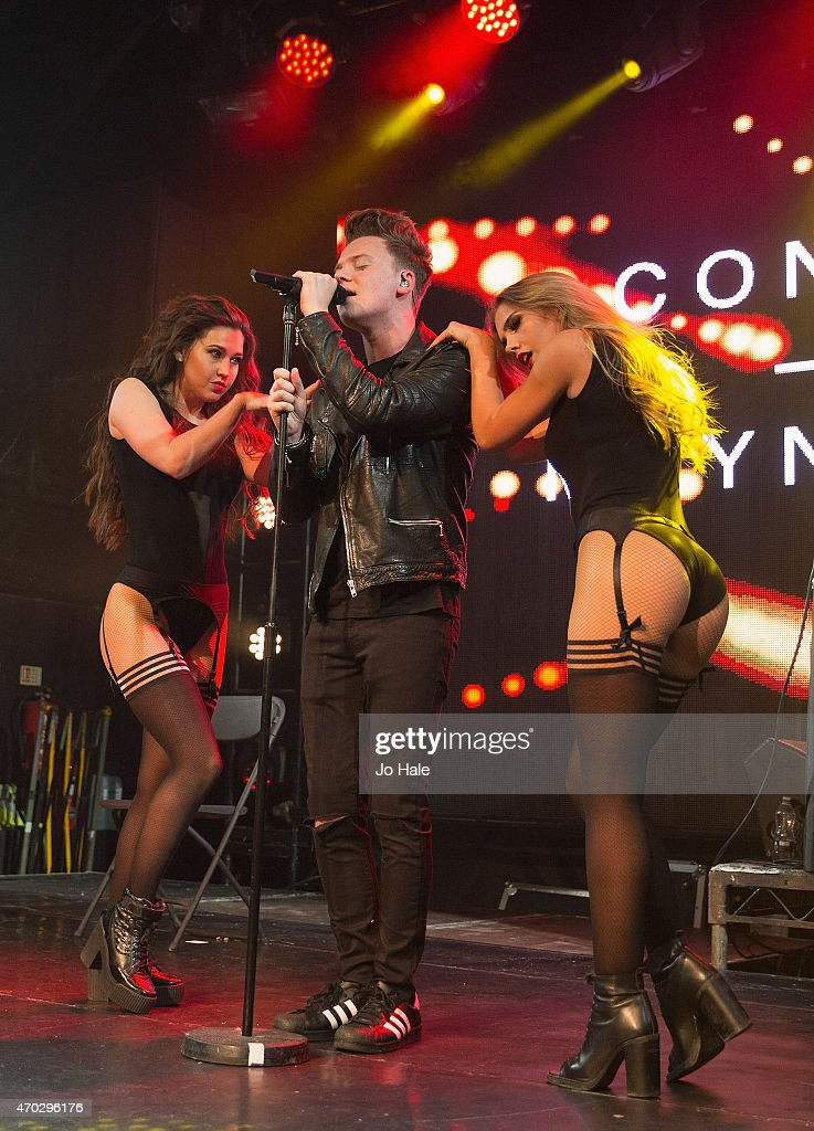 Conor Maynard performs on stage with female dancers at Heaven on April 18 2015 in London United Kingdom