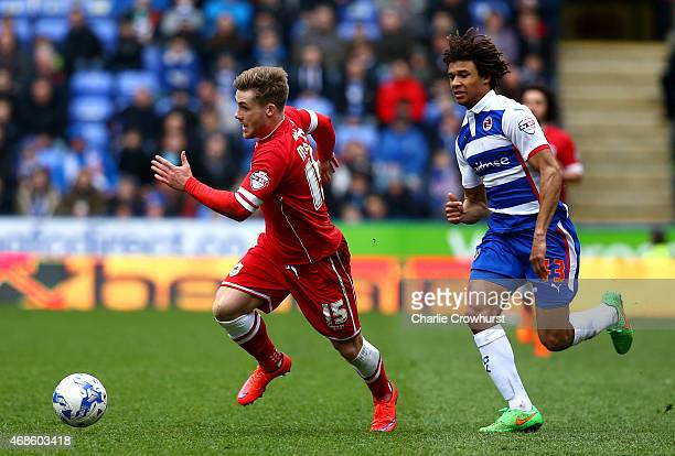 Conor McAleny of Cardiff breaks away from Reading's Nathan Ake during the Sky Bet Championship match between Reading and Cardiff City at The Madejski...