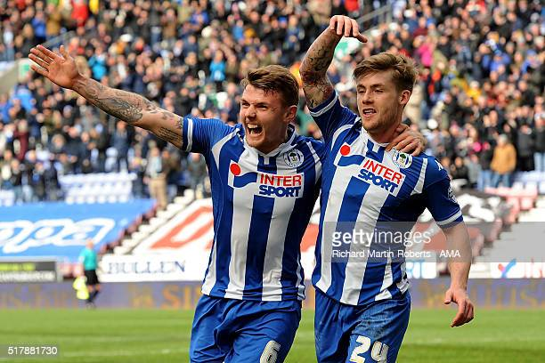 Conor McAleny of Wigan Athletic celebrates scoring the first goal with teammate Max Power during the Sky Bet Football League One match between Wigan...