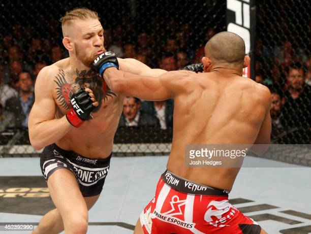 Conor McGregor and Diego Brandao trade punches in their featherweight bout during the UFC Fight Night event at The O2 Dublin on July 19 2014 in...