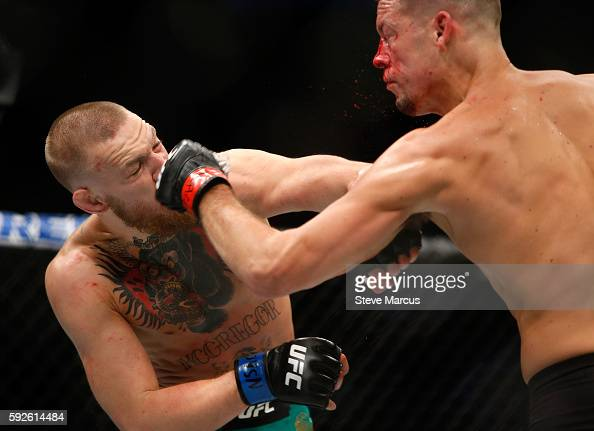 Conor McGregor and Nate Diaz trade blows during their welterweight rematch at the UFC 202 event at TMobile Arena on August 20 2016 in Las Vegas Nevada
