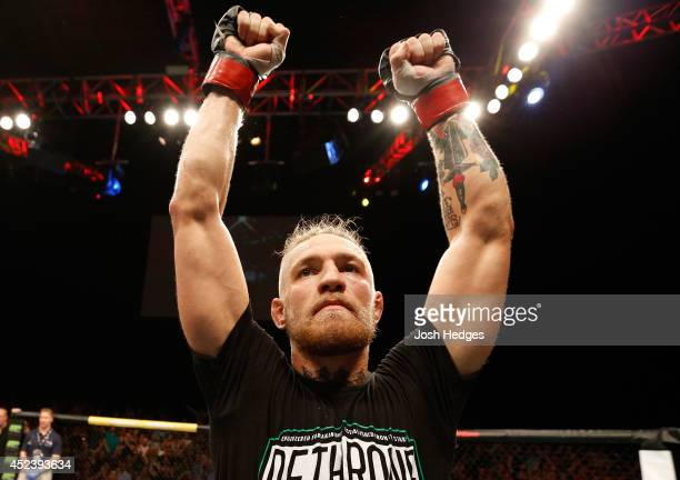 Conor McGregor celebrates after his TKO victory over Diego Brandao in their featherweight bout during the UFC Fight Night event at The O2 Dublin on...