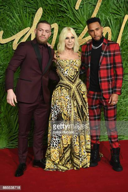 Conor McGregor Donatella Versace and Lewis Hamilton attend The Fashion Awards 2017 in partnership with Swarovski at Royal Albert Hall on December 4...