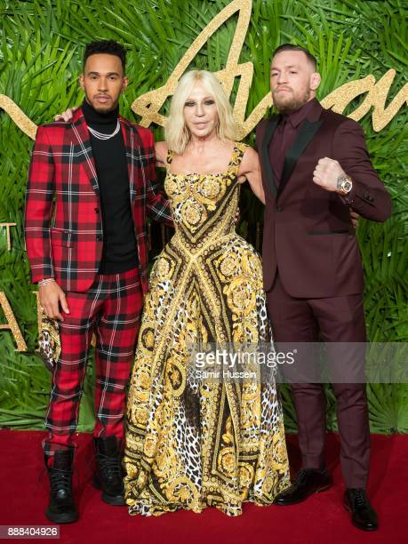 Conor McGregor Donatella Versace Lewis Hamilton attends The Fashion Awards 2017 in partnership with Swarovski at Royal Albert Hall on December 4 2017...