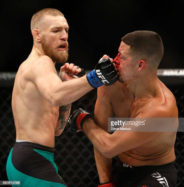 Conor McGregor hits Nate Diaz with a right during their welterweight rematch at the UFC 202 event at TMobile Arena on August 20 2016 in Las Vegas...