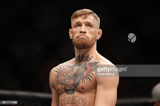 Conor McGregor is shown in the Octagon before his featherweight title fight against Jose Aldo during UFC 194 at MGM Grand Garden Arena on December 12...