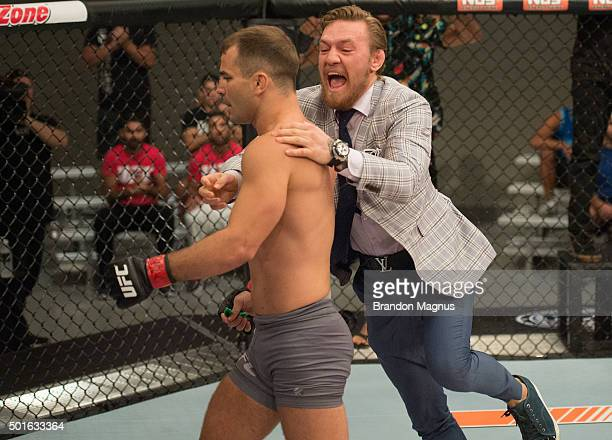Conor McGregor jumps into the cage to congratulate Artem Lobov after his knockout victory over Julian Erosa during the filming of The Ultimate...