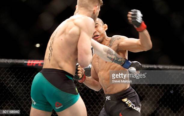 Conor McGregor knocks out Jose Aldo in the first round of their featherweight title fight during UFC 194 on December 12 2015 in Las Vegas Nevada