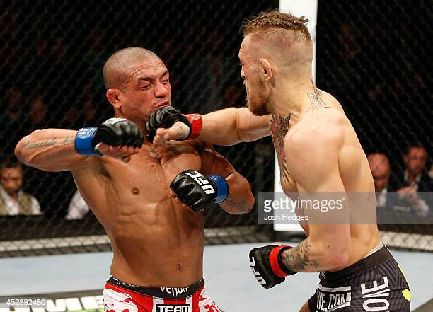 Conor McGregor lands a right to the head of Diego Brandao in their featherweight bout during the UFC Fight Night event at The O2 Dublin on July 19...