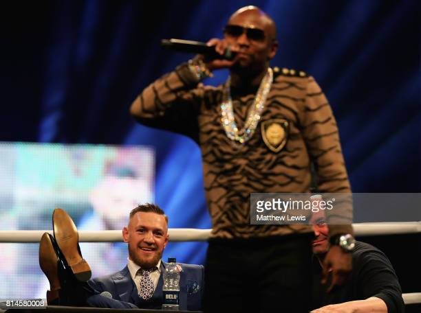 Conor McGregor looks on as Floyd Mayweather Jr talks to the crowd during the Floyd Mayweather Jr v Conor McGregor World Press Tour at SSE Arena on...