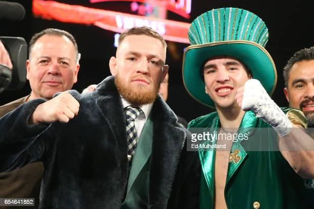 Conor McGregor Michael Conlan celebrate Conlan's 3rd round TKO win over Tim Ibarra in his super bantamweight bout at The Theater at Madison Square...