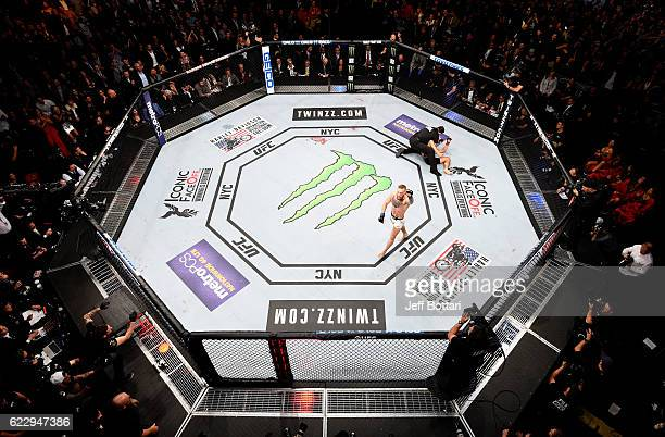 Conor McGregor of Ireland celebrates his KO victory over Eddie Alvarez of the United States in their lightweight championship bout during the UFC 205...