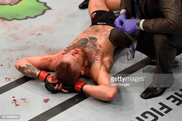 Conor McGregor of Ireland is inspected by physicians during the UFC 196 event inside MGM Grand Garden Arena on March 5 2016 in Las Vegas Nevada