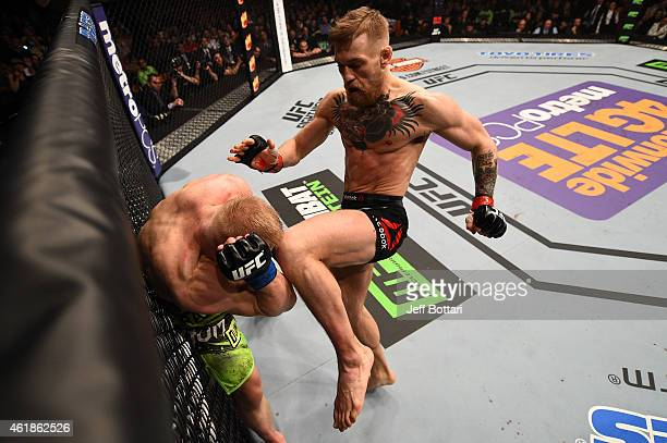 Conor McGregor of Ireland lands a knee to the head of Dennis Siver of Germany in their featherweight fight during the UFC Fight Night event at the TD...