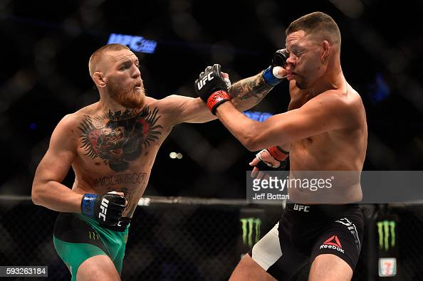 Conor McGregor of Ireland punches Nate Diaz in their welterweight bout during the UFC 202 event at TMobile Arena on August 20 2016 in Las Vegas Nevada