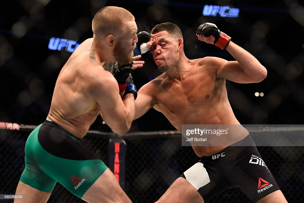 Conor McGregor of Ireland punches Nate Diaz in their welterweight bout during the UFC 202 event at T-Mobile Arena on August 20, 2016 in Las Vegas, Nevada.