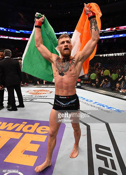 Conor McGregor of Ireland reacts after defeating Dennis Siver of Germany in their featherweight fight during the UFC Fight Night event at the TD...