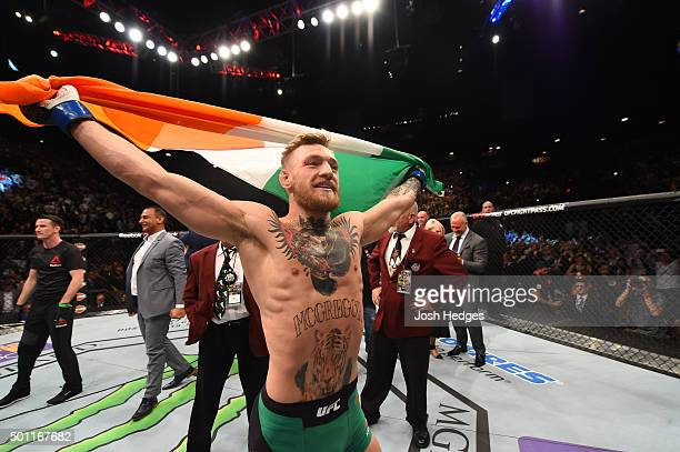 Conor McGregor of Ireland reacts to his victory over Jose Aldo of Brazil in their UFC featherweight championship bout during the UFC 194 event inside...