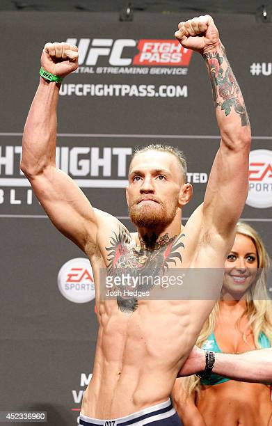 Conor McGregor poses on stage after weighing in during the UFC weighin event at The O2 on July 18 2014 in Dublin Ireland