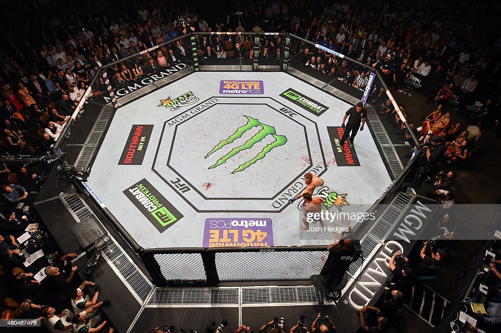 Conor McGregor punches Chad Mendes in their UFC interim featherweight title fight during the UFC 189 event inside MGM Grand Garden Arena on July 11, 2015 in Las Vegas, Nevada.