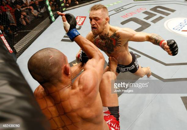Conor McGregor punches Diego Brandao in their featherweight bout during the UFC Fight Night event at The O2 Dublin on July 19 2014 in Dublin Ireland