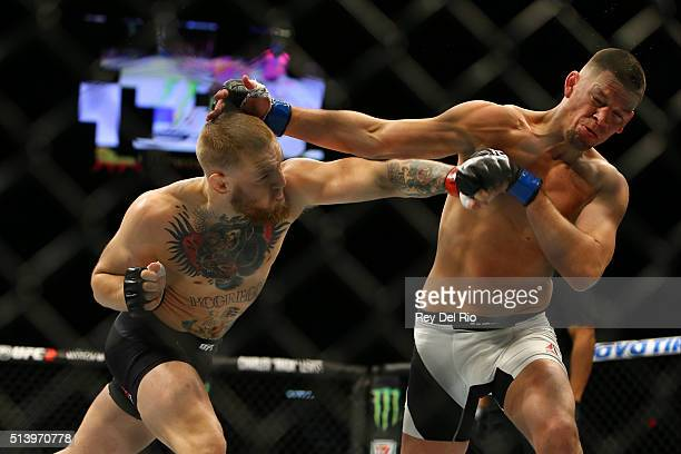 Conor McGregor punches Nate Diaz during UFC 196 at the MGM Grand Garden Arena on March 5 2016 in Las Vegas Nevada