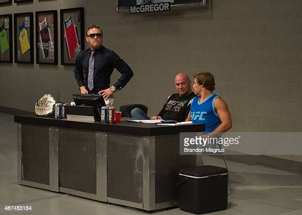 Conor McGregor reacts to his teammate Artem Lobov's loss to Mehdi Baghdad during the elimination fights at the UFC TUF Gym on July 17 2015 in Las...