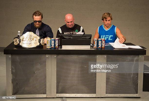 Conor McGregor UFC president Dana White and Urijah Faber prepare to watch the elimination fights at the UFC TUF Gym on July 17 2015 in Las Vegas...