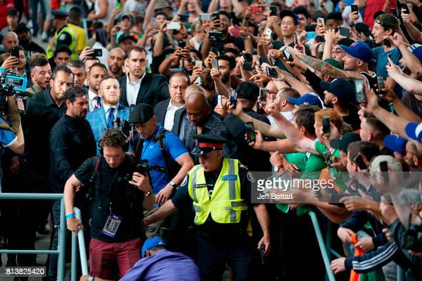 Conor McGregor walks through the crowd to be introduced during the Floyd Mayweather Jr v Conor McGregor World Press Tour event at the Budweiser Stage...