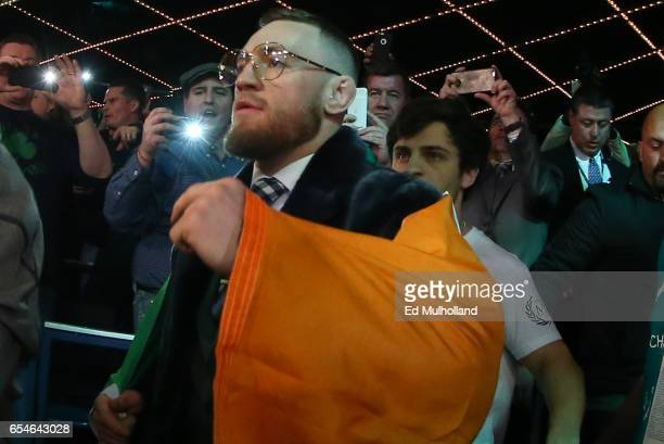 Conor McGregor walks to the ring for the super bantamweight bout between Michael Conlan and Tim Ibarra at The Theater at Madison Square Garden on...