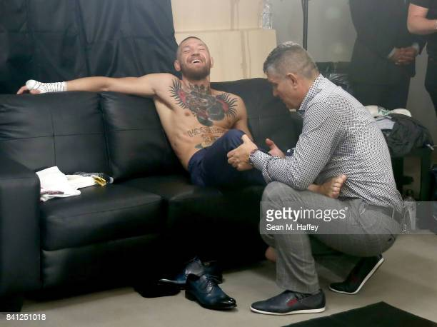 Conor McGregor warms up in his locker room prior to his super welterweight boxing match against Floyd Mayweather Jr on August 26 2017 at TMobile...