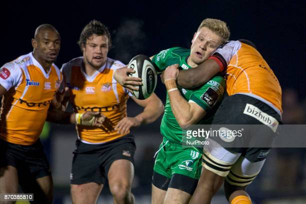 Conor McKeon of Connacht tackled by Junior Pokomela of Cheetahs during the Guinness PRO14 Round 8 rugby match between Connacht Rugby and Toyota...