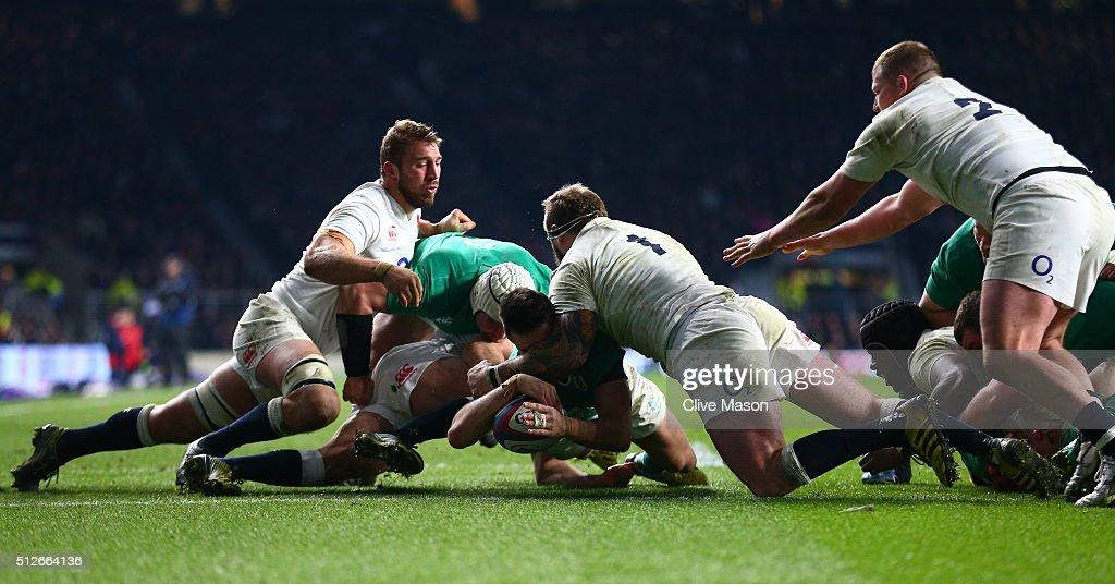 Conor Murray of Ireland burrows over to score the opening try during the RBS Six Nations match between England and Ireland at Twickenham Stadium on February 27, 2016 in London, England.